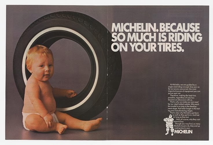 "A Michelin advert with a baby sitting by a car tire, with the tag line ""Michelin, because so much is riding on your tires."""