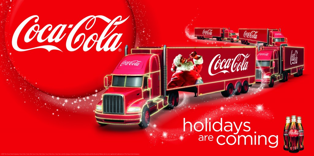 A Coca-Cola advert with a big red Coca-Cola truck with Santa Clause featured on the side, drinking a Coca-Cola drink, with the tag line 'holidays are coming'.