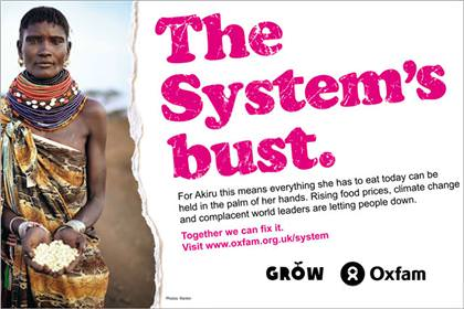 An Oxfam advert with a woman showing her entire food for the day fit into the palm of her hands, with the caption 'The System's bust'