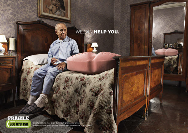 An advertisement showing an elderly man sitting on his bed with an giant pill on the bed beside him, and the tag line 'we can help you', to advertise a nursing service who have run a campaign that for elderly people, small tasks become much bigger.