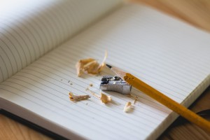 A picture of a pencil and paper, used for writing for SEO