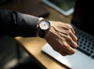 Image of a man checking his watch