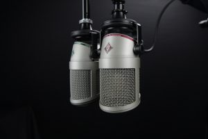 An image of two hanging microphones, used to represent voice search