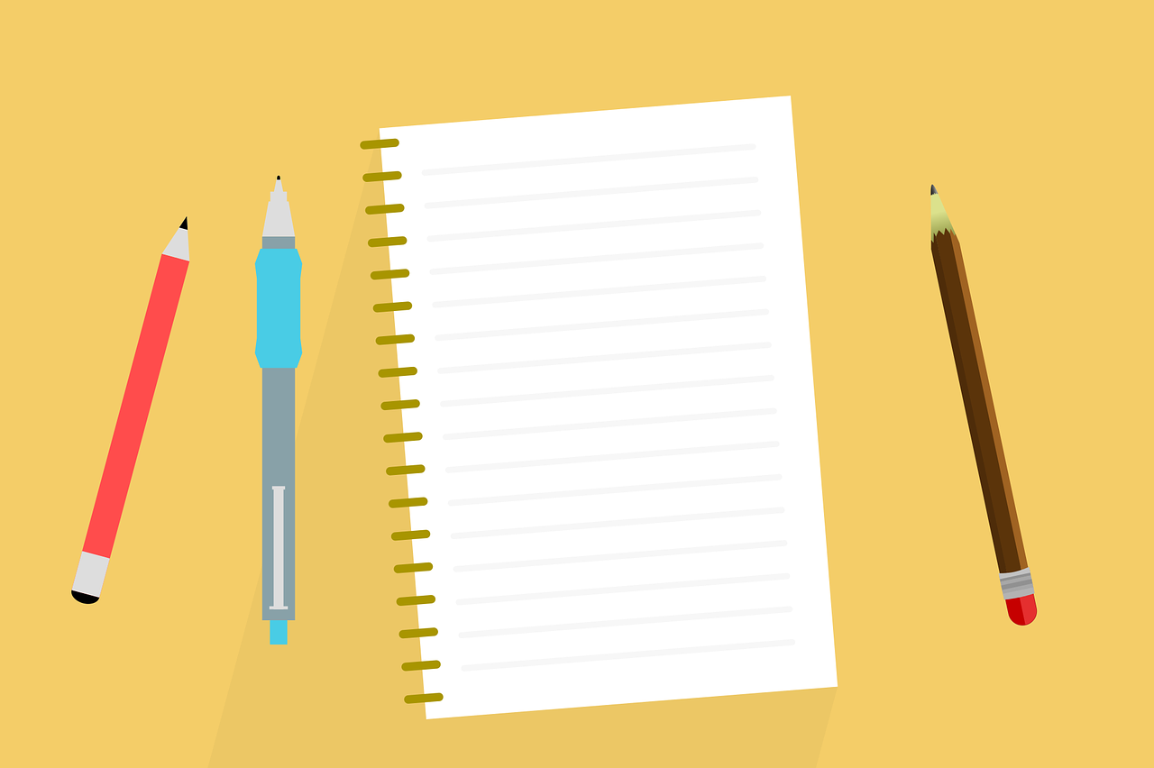 A cartoon image of a lined notepad and writing equipment.